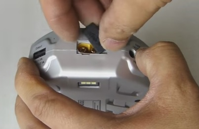 The Tip of the unit has a plug for the car battery jump starter or a cigarette lighter charger accessory.